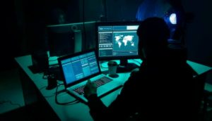 A Man Studying Colonial Pipe Ransomware Hack & Gas Shortage